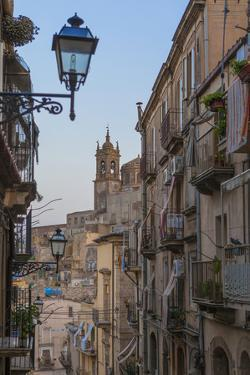 Street lanterns and houses in the typical alleys of the old town, Caltagirone, Province of Catania, by Roberto Moiola