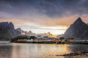 Sunset on the Fishing Village Framed by Rocky Peaks and Sea, Sakrisoya, Nordland County by Roberto Moiola