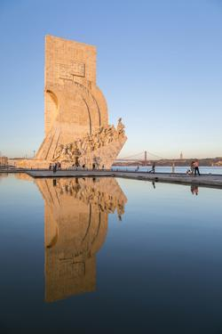 Sunset on the Padrao Dos Descobrimentos (Monument to the Discoveries) Reflected in Tagus River by Roberto Moiola