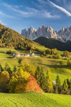 Sunset over the Odle Group and village of Santa Magdalena in autumn, Italy by Roberto Moiola