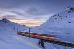 The Bernina Express Red Train, UNESCO World Heritage Site, Graubunden, Swiss Alps, Switzerland by Roberto Moiola