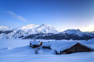 The Blue Hour Leaving its Place to the Night over Some Scattered Huts in Spluga by the Maloja Pass by Roberto Moiola