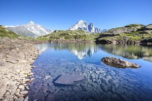 The Mont Blanc Mountain Range Reflected in the Waters of Lac Des Cheserys by Roberto Moiola