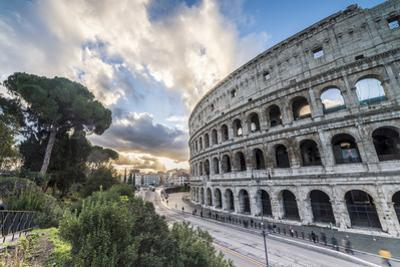 The pink sky at sunrise frames the ancient Colosseum (Flavian Amphitheatre), UNESCO World Heritage  by Roberto Moiola