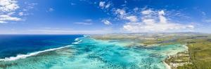 Turquoise coral reef meeting the waves of the Indian Ocean, Mauritius by Roberto Moiola