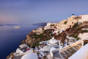 View of the Aegean Sea from the Typical Greek Village of Oia at Dusk, Santorini, Cyclades by Roberto Moiola