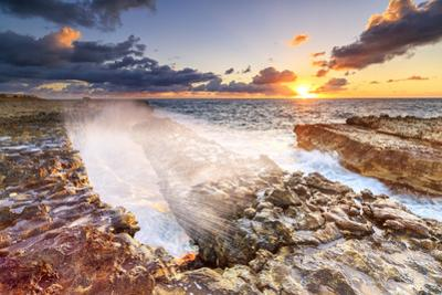 Waves crashing on cliffs at sunrise, Devil's Bridge, Antigua, Antigua and Barbuda, Leeward Islands by Roberto Moiola