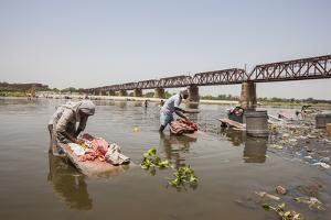 Women Wash Clothes in the Polluted Water of the Yamuna River by Roberto Moiola