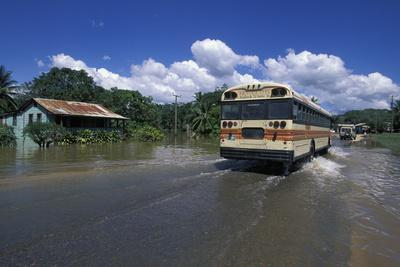 A Bus Driving Through a Flooded Street after a Hurricane, Belize