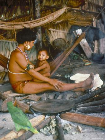 Yanomami Mother and Child, Brazil, South America by Robin Hanbury-tenison