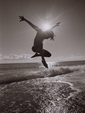 Silhouette of Dancer Jumping Over Atlantic Ocean by Robin Hill