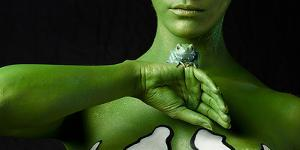 A Body Painted Conservationist with a Waxy Monkey Frog, Phyllomedusa Sauvagii by Robin Moore