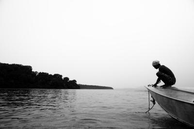 A Solomon Islander Brings the Anchor on Board Off Tetapare by Robin Moore