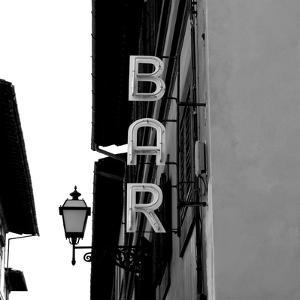 Black and White Neon Lights Spelling BAR in the Street by Robin Nieuwenkamp