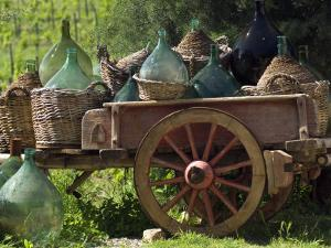 Discarded Wine Demijohns in Cart at Villa a Sesta by Rocco Fasano