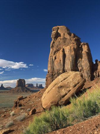 https://imgc.allpostersimages.com/img/posters/rock-formations-caused-by-erosion-in-a-desert-landscape-in-monument-valley-arizona-usa_u-L-P7XJXO0.jpg?p=0