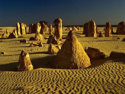 https://imgc.allpostersimages.com/img/posters/rock-formations-in-the-sand-of-the-pinnacles-desert-nambung-national-park-western-australia_u-L-P4FRJP0.jpg?p=0