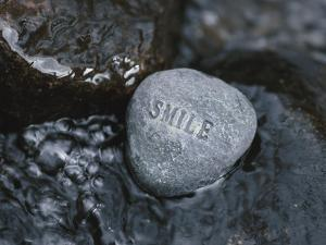 Rock with the Word Smile in Rushing Water