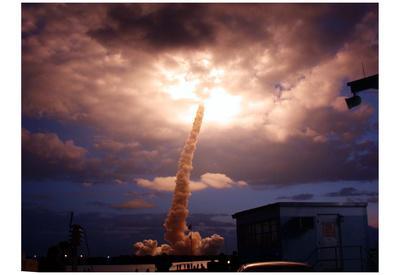 https://imgc.allpostersimages.com/img/posters/rocket-launch-into-clouds-art-poster-print_u-L-F59B530.jpg?p=0