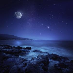 Rocks Seaside Against Rising Moon and Starry Field, Crete, Greece