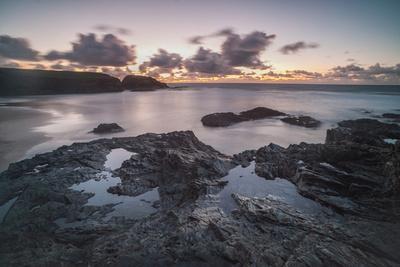 https://imgc.allpostersimages.com/img/posters/rocky-coast-at-treyarnon-bay-at-sunset-cornwall-england-united-kingdom-europe_u-L-PQ8MPZ0.jpg?p=0