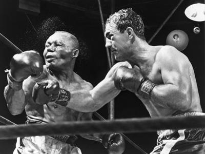 Rocky Marciano Landing a Punch on Jersey Joe Walcott, Sept. 23, 1952