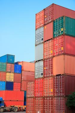 Stack of Cargo Containers at Sunrise in an Intermodal Yard by rodho
