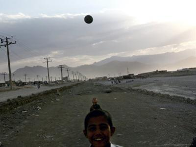 Afghan Boys Play with a Ball in Kabul, Afghanistan, Friday, July 7, 2006