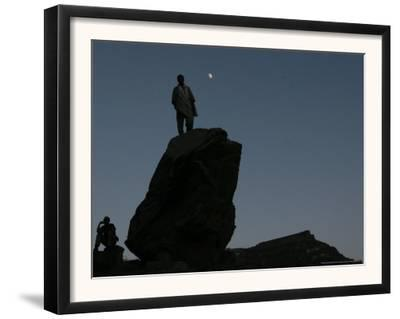 An Afghan Man Stands on a Huge Rock Next to the Now Abad Dinazung Monument