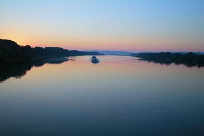 A Freight Barge Motors Up the Beautiful Blue Danube River by Tulln an Der Donau, Austria