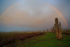 An Evening Storm Leaves a Rainbow over the 5000 Year Old Ring of Brodgar on Mainland Island by Roff Smith