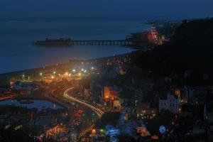 Lights Twinkle in the English Seaside Resort Town of Hastings on the Sussex Coast by Roff Smith
