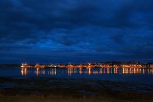 The Harbor and Ferry Port at Kirkwall on a Rainy Summer Night by Roff Smith