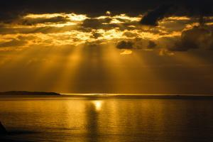 The Rising Sun Casts a Fan of Golden Light over the Sir Francis Drake Channel, Off Tortola by Roff Smith