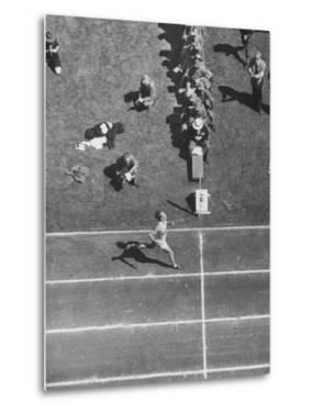 Roger Bannister Finishing a Race During the British Empire Games