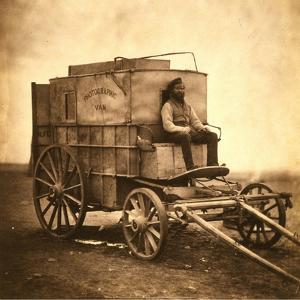 Marcus Sparling, Lull-Length Portrait, Seated on Roger Fenton's Photographic Wagon, 1855 by Roger Fenton