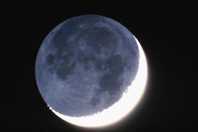 Crescent Moon with Earthshine by Roger Ressmeyer