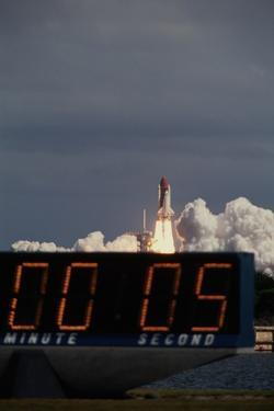 Space Shuttle Discovery Lifting Off and Countdown Clock by Roger Ressmeyer