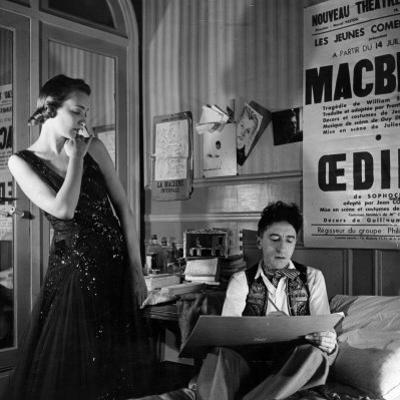 Jean Cocteau Sketching Model Elizabeth Gibbons in a Chanel Dress in His Hotel Bedroom