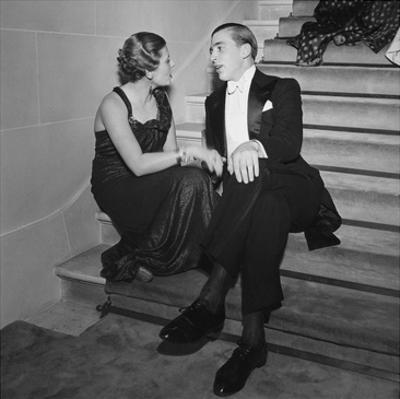 Vogue - May 1935 - Elegant Couple Talking on Staircase