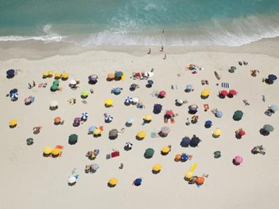 Umbrella Pattern on Beach by Roger Wright