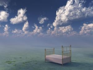 Bed In Surreal Peaceful Landscape by rolffimages