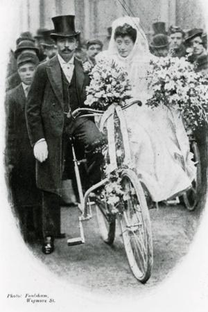 https://imgc.allpostersimages.com/img/posters/roman-catholic-couple-leaving-notre-dame-de-france-leicester-square-on-bicycles_u-L-PLUNDR0.jpg?p=0