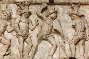 Rome, Italy. Bas relief in the Colosseum of gladiators fighting.