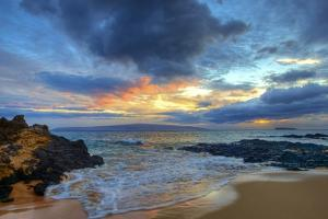 Sunset over Secret Beach at Makena on Maui by Ron Dahlquist