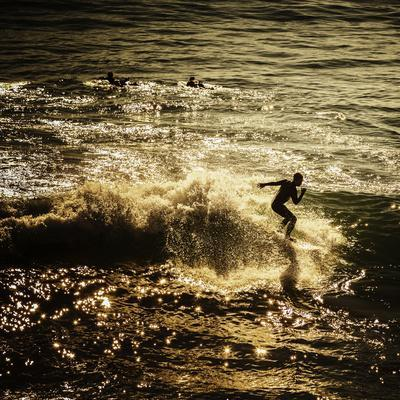 A Male Surfer Rides A Wave In The Pacific Ocean Off The Coast Of Santa Cruz This Image Tinted