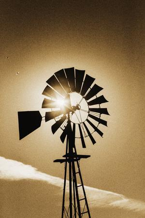 An Old Windmill Backlit In The Early Morning Light Along Highway 25 In San Benito County