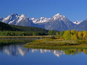 Teton Mountain Range Reflected in the Snake River by Ron Watts
