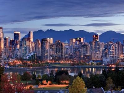 Vancouver skyline in front of North Shore Mountains by Ron Watts