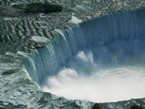 Water Rushing over Horseshoe Falls by Ron Watts